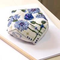 Cornflower Biscornu as paperweight